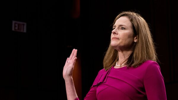 U.S. Supreme Court nominee Amy Coney Barrett is sworn in during her confirmation hearing before the Senate Judiciary Committee on Capitol Hill in Washington , D.C., U.S., October 12, 2020. - Sputnik International