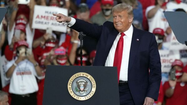 President Donald Trump arrives at a campaign rally at the Orlando Sanford International Airport Monday, Oct. 12, 2020, in Sanford, Fla. - Sputnik International