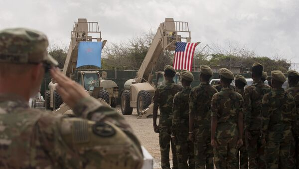 Somali national army soldiers stand in formation during a logistics course graduation ceremony. Soldiers from Somali's advanced infantry DANAB battalion spent 14 weeks training with the U.S. 10th Mountain division on the importance of logistical operation as well as the operation and maintenance of heavy equipment. - Sputnik International