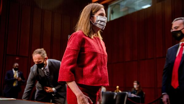 US Supreme Court nominee Judge Amy Coney Barrett departs at the end of the more than eleven hour-long second day of her nomination hearing before the US Senate Judiciary Committee on Capitol Hill in Washington, October 13, 2020 - Sputnik International