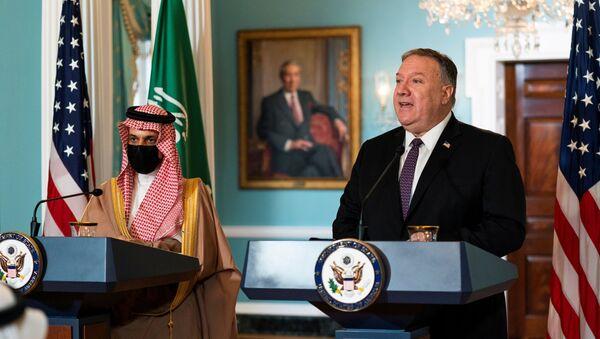 Saudi Minister of Foreign Affairs Prince Faisal bin Farhan Al Saud listens to U.S. Secretary of State Mike Pompeo as he speaks during their meeting at the State Department, in Washington, U.S., October 14, 2020. Manuel Balce Ceneta/Pool via REUTERS - Sputnik International