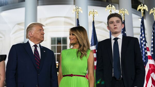 In this Aug. 27, 2020 file photo, Barron Trump right, stands with President Donald Trump and first lady Melania Trump on the South Lawn of the White House on the fourth day of the Republican National Convention in Washington. - Sputnik International