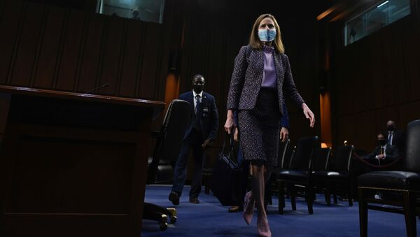 Supreme Court nominee Judge Amy Coney Barrett leaves after testifying on the third day of her confirmation hearing before the Senate Judiciary Committee on Capitol Hill on October 14, 2020 in Washington, DC. - Sputnik International