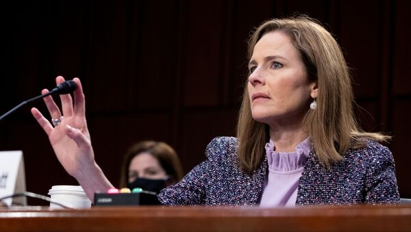 Judge Amy Coney Barrett tests her microphone after it failed several times during the third day of her Senate confirmation hearing to the Supreme Court on Capitol Hill in Washington, DC, U.S., October 14, 2020. - Sputnik International