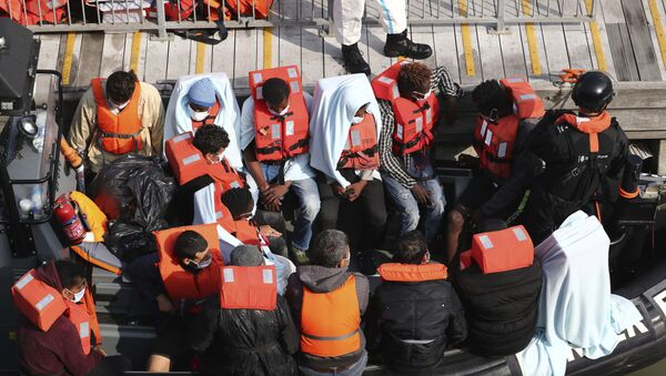 A group of people, thought to be migrants wait on a Border Force rib to come ashore at Dover marina in Kent, England after a small boat incident in the English Channel, Tuesday Sept. 22, 2020.  - Sputnik International