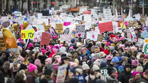 Demonstrators carry signs during the 2020 Women's March on January 18, 2020 in Washington, DC. Marches were held nationwide in cities including New York and Los Angeles.  - Sputnik International