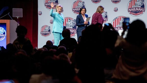 Democrat presidential candidate Hillary Clinton, left, accompanied by NBC reporter Kristen Welker, center, and Telemundo reporter Lori Montenegro, waves as she leaves after speaking at the 2016 National Association of Black Journalists' and National Association of Hispanic Journalists' Hall of Fame Luncheon at Marriott Wardman Park in Washington, Friday, 5 August 2016. - Sputnik International