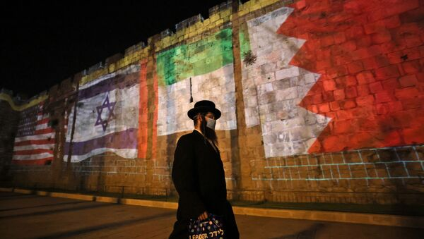 The flags of US, Israel, United Arab Emirates, and Bahrain are projected on the ramparts of Jerusalem's Old City on September 15, 2020 in a show of support for Israeli normalisation deals with the United Arab Emirates and Bahrain. - Sputnik International
