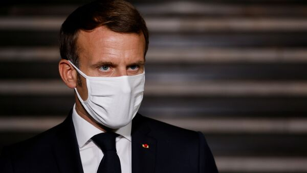 French President Emmanuel Macron wearing a face mask delivers a speech at the end of a visit about the fight against separatism at the Seine-Saint-Denis prefecture headquarters in Bobigny, near Paris, France October 20, 2020.  - Sputnik International