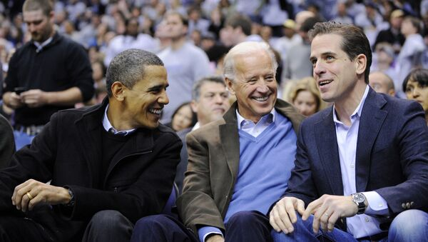 This Jan. 30, 2010 file photo shows Hunter Biden, right, son of Vice President Joe Biden, center, talking with President Barack Obama, and the vice president Joe Biden during a college basketball game in Washington.  Biden's youngest son Hunter is joining the Navy. The Navy says the attorney and former Washington lobbyist was selected to be commissioned into the Navy Reserve as a public affairs officer. Because he is 42, he needed a special waiver to be accepted, but that is not uncommon. He is one of seven candidates recommended for a direct commission for public affairs.  - Sputnik International