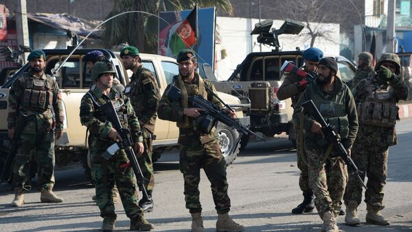 Afghan security personnel keep watch along a street after an attack from a building close to the Pakistan consulate in Jalalabad (File) - Sputnik International