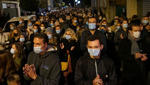 People attend a silent march to pay tribute to Samuel Paty, the French teacher who was beheaded on the streets of the Paris suburb of Conflans-Sainte-Honorine, France, October 20, 2020 - Sputnik International