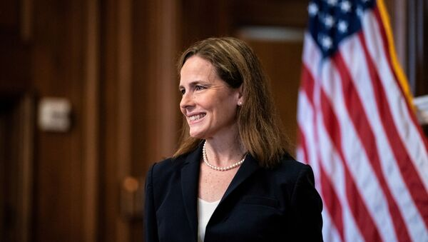 Judge Amy Coney Barrett, U.S. President Donald Trump's Nominee for Supreme Court, poses for a photo before a meeting with Senator Roy Blunt (R-Mo) on Capitol Hill in Washington DC, U.S. October 21, 2020.  - Sputnik International