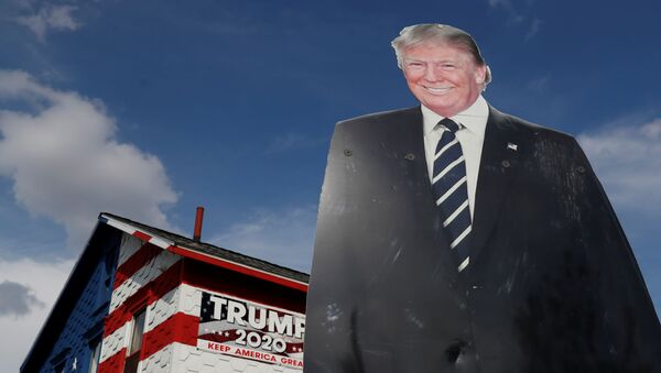 A 14-foot cutout of U.S. President Donald Trump stands on the front lawn of the self-proclaimed 'Trump House' in Youngstown, Pennsylvania, U.S., October 21, 2020. - Sputnik International