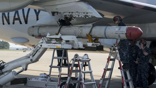 Aviation Ordnanceman 3rd Class Michael Martin, left,, and Aviation Ordnanceman Airman Cecilia Duran, both assigned to the Pro's Nest of Patrol Squadron (VP) 30, load an AGM-84K SLAM-ER missile on a P-8A Poseidon in preparation for a conventional weapons technical proficiency inspection. - Sputnik International