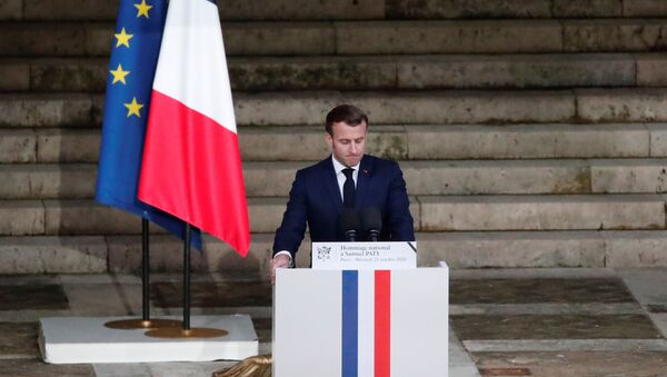 French President Emmanuel Macron delivers his speech in front of the coffin of slain teacher Samuel Paty during a national memorial event, in Paris, France October 21, 2020.  - Sputnik International