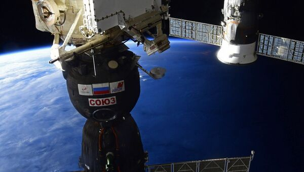 A Roscosmos Soyuz MS-16 spacecraft preparing to undock from the International Space Station (ISS) before returning to Earth. - Sputnik International