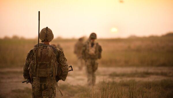 Soldiers on patrol in farmlands in Helmand Province, Afghanistan on 12 September 2011 - Sputnik International