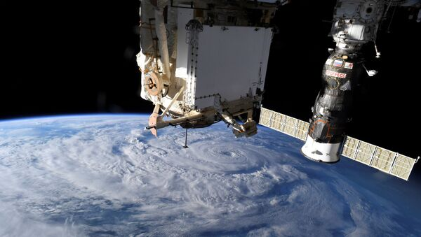 Hurricane Genevieve is seen from the International Space Station (ISS) orbiting Earth in an image taken by NASA astronaut Christopher J. Cassidy August 19, 2020. - Sputnik International
