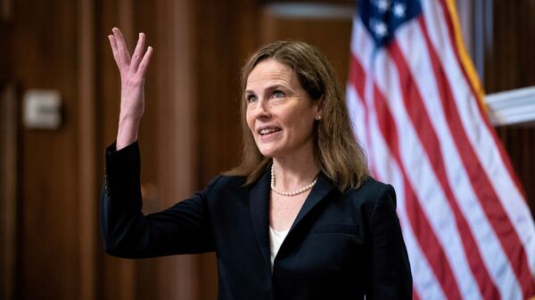 FILE PHOTO: Judge Amy Coney Barrett, U.S. President Donald Trump's Nominee for Supreme Court, gestures during a photo before a meeting with Senator Roy Blunt (R-Mo) on Capitol Hill in Washington DC, U.S. October 21, 2020 - Sputnik International