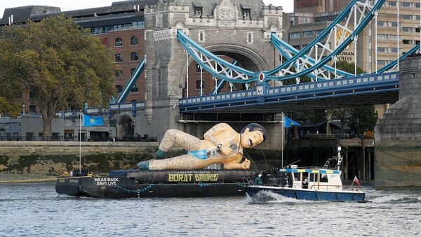 An inflatable Borat character promoting movie Borat Subsequent Moviefilm is carried along the River Thames from Tower Bridge aboard a barge, in London, Britain October 22, 2020.  - Sputnik International