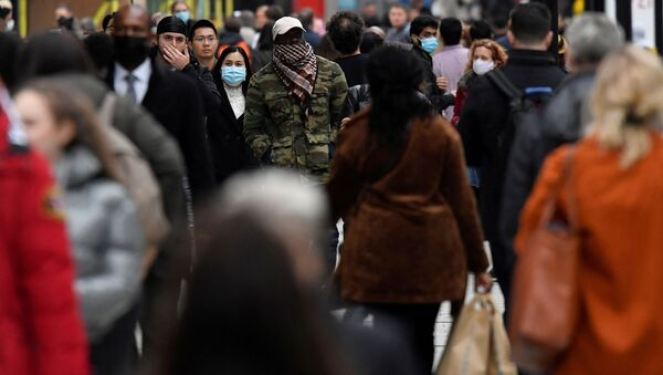 FILE PHOTO: Shoppers walk along Oxford Street, in the centre of London's retail shopping area, amid the spread of the coronavirus disease (COVID-19) in London, Britain, October 16, 2020 - Sputnik International