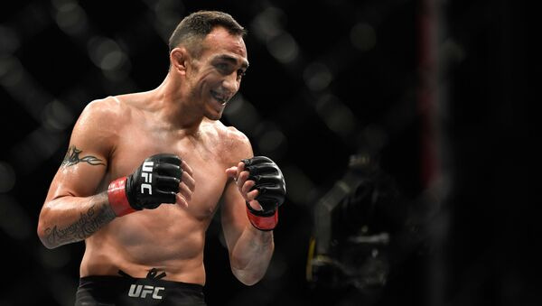 Tony Ferguson of the United States reacts in the Interim lightweight title fight against Justin Gaethje (not pictured) of the United States during UFC 249 at VyStar Veterans Memorial Arena on May 9, 2020 in Jacksonville, Florida - Sputnik International