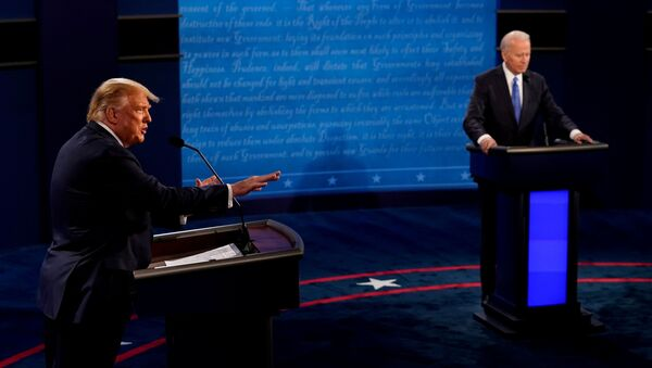 U.S. President Donald Trump answers a question as Democratic presidential candidate former Vice President Joe Biden listens during the final presidential debate at the Curb Event Center at Belmont University in Nashville, Tennessee, U.S - Sputnik International