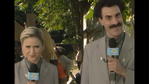 A screenshot from a video posted on the Twitter account of 'Borat Sagdiyev', the satirical fictional character played by British actor and comedian Sacha Baron Cohen, showing Borat and Bulgarian actress Mara Bakalova, who plays his daughter in the newly-released movie 'Borat Subsequent Moviefilm'. - Sputnik International