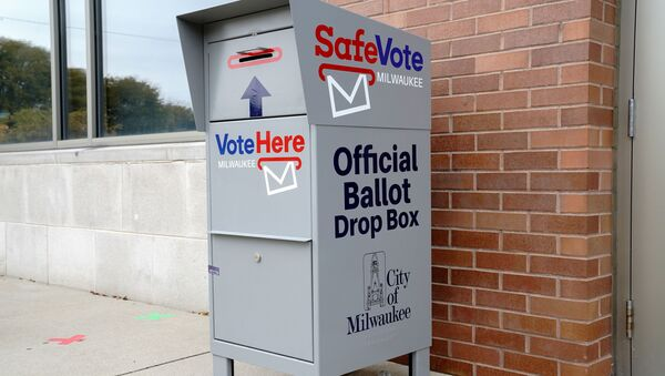 A SafeVote official ballot drop box for mail-in ballots is seen outside a polling site at the Milwaukee Public Library's Washington Park location in Milwaukee, on the first day of in-person voting in Wisconsin, U.S., October 20, 2020. - Sputnik International