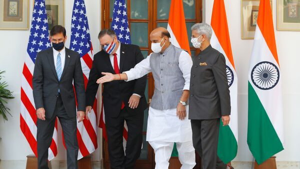 India's Defence Minister Rajnath Singh gestures to show the way to US Secretary of State Mike Pompeo and US Defense Secretary Mark Esper after they posed for a picture with India's Foreign Minister Subrahmanyam Jaishankar during a photo opportunity ahead of their meeting at Hyderabad House in New Delhi, India, October 27, 2020 - Sputnik International