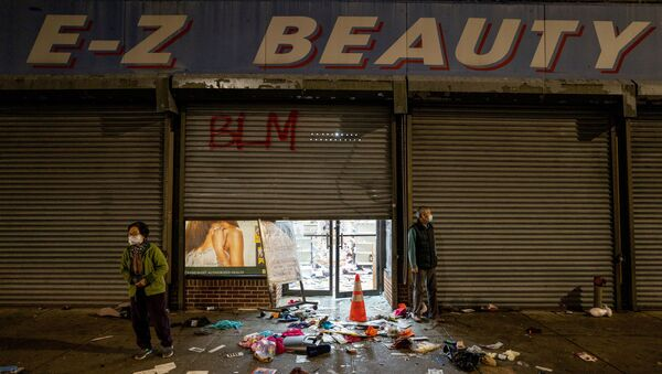 A business owner stands outside of her looted beauty supply store following protests over the police shooting death of Walter Wallace in Philadelphia, Pennsylvania, U.S., October 27, 2020. - Sputnik International