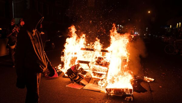 Fire burns as demonstrators clash with riot police during a rally after the death of Walter Wallace Jr., a Black man who was shot by police in Philadelphia, Pennsylvania, U.S., October 27, 2020 - Sputnik International