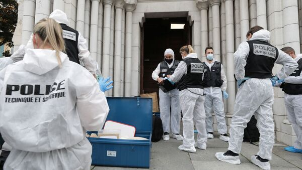 Forensic specialists inspect the scene of a reported knife attack at Notre Dame church in Nice, France, October 29, 2020 - Sputnik International