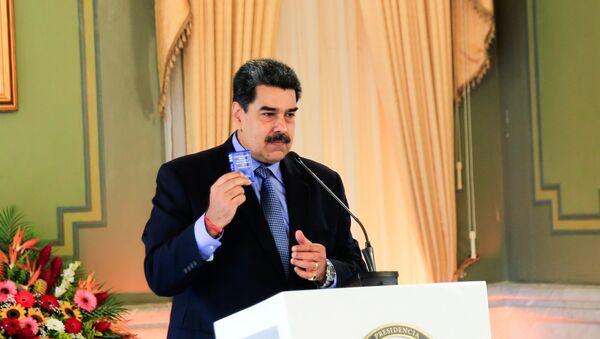 Venezuela's President Nicolas Maduro holds a virtual news conference in Caracas, Venezuela October 28, 2020 - Sputnik International