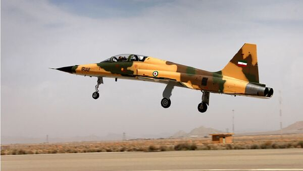 A handout picture released by Iran's Defence Ministry on August 21, 2018, shows the  Kowsar domestic fighter jet, a fourth-generation fighter, with advanced avionics and multi-purpose radar, which the local Tasnim news agency said was 100-percent indigenously made. - Iran unveiled its first domestic fighter jet at a defence show in the capital Tehran today. - Sputnik International
