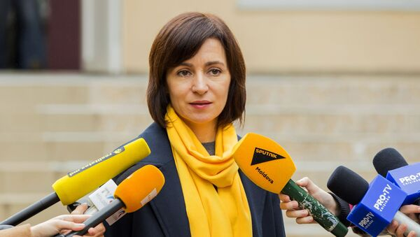 Prime Minister of the Republic of Moldova Maia Sandu answers questions from reporters during the elections at the polling station in Chisinau on October 20, 2019 during the local government elections in Moldova. - Sputnik International