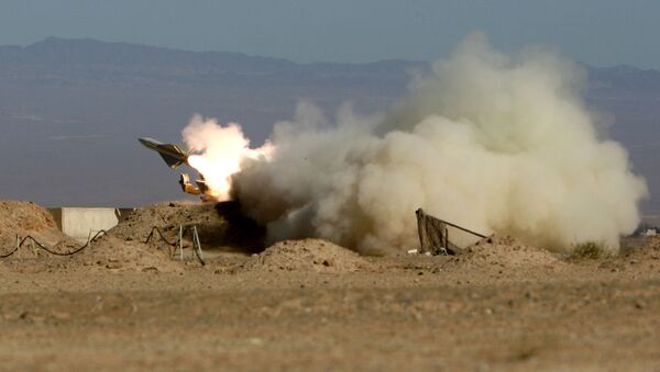 Iran's armed forces fires a missile during its air defense war game in the Isfahan province south of the capital Tehran, Iran, Wednesday, Nov. 25, 2009 - Sputnik International