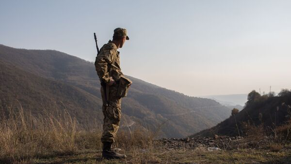 An armed man is pictured in the area of the Lachin corridor, the self-proclaimed Nagorno-Karabakh Republic - Sputnik International
