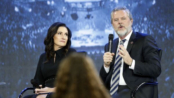In this Wednesday, Nov. 28, 2018 file photo, Jerry Falwell Jr., right, answers a student's question, accompanied by his wife, Becki, during a town hall meeting on the opioid crisis at a convocation at Liberty University in Lynchburg, Va. On Aug. 7, 2020, Falwell stepped down, at least temporarily, from his role as the president of the school. - Sputnik International