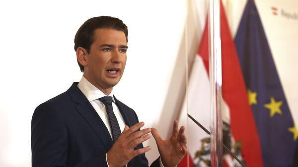 Austrian Chancellor Sebastian Kurz speaks during a press conference behind plexiglass shields at the federal chancellery in Vienna, Austria, Saturday, Oct. 31, 2020. - Sputnik International