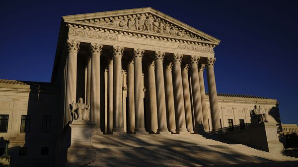 In this Monday, Nov. 2, 2020, file photo the Supreme Court is seen at sundown on the eve of Election Day, in Washington - Sputnik International