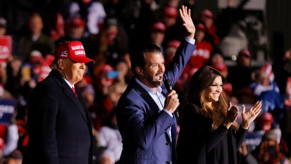 Kimberly Guilfoyle and Donald Trump Jr. wave and clap next to U.S. President Donald Trump during a campaign rally at Kenosha Regional Airport in Kenosha, Wisconsin, U.S., November 2, 2020. - Sputnik International