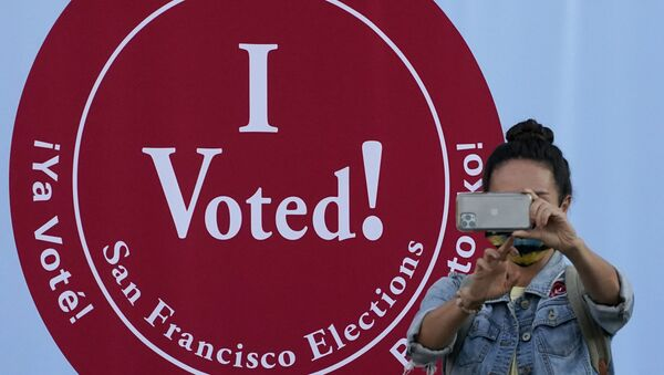A woman takes a photo in front of an I Voted sign at a San Francisco Department of Elections voting center in San Francisco, Monday, Nov. 2, 2020, ahead of Election Day.  - Sputnik International