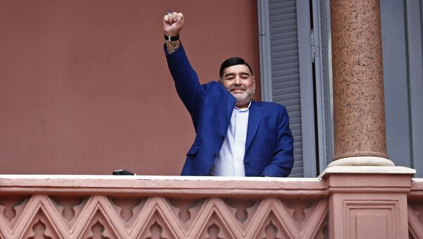 Former soccer great Diego Maradona acknowledges fans below at the Casa Rosada government house after his meeting with Argentine President Alberto Fernandez in Buenos Aires, Argentina, Thursday, Dec. 26, 2019. - Sputnik International