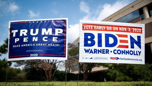FILE PHOTO: Yard signs supporting U.S. President Donald Trump and Democratic U.S. presidential nominee and former Vice President Joe Biden are seen outside of an early voting site at the Fairfax County Government Center in Fairfax, Virginia, U.S., September 18, 2020. REUTERS/Al Drago/File Photo - Sputnik International