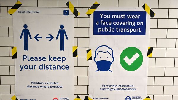 Posters advise people on social distancing and the wearing of face coverings on the underground network, at Notting Hill tube station in London, on June 15, 2020 after new rules make wearing face coverings on public transport compulsory while the UK further eases its coronavirus lockdown. - Sputnik International