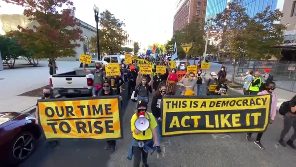 Protesters march in Washington, DC, on November 4, 2020, against US President Donald Trump's premature declaration of victory in the US presidential election the day prior - Sputnik International