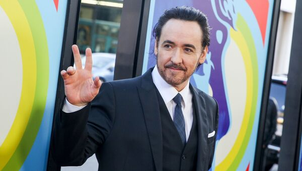 In this June 2, 2015 file photo, actor John Cusack arrives at the premiere of Love & Mercy in Beverly Hills, Calif. Cusack has apologized for tweeting an anti-Semitic cartoon and quotation after initially defending the post, then deleting it.  - Sputnik International