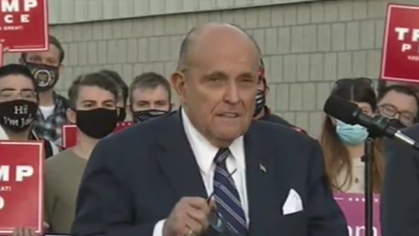 Rudy Giuliani speaks to reporters in Pennsylvania on November 4, 2020, about the Donald Trump campaign filing lawsuits to stop what he claims are fraudulent vote counts in the state - Sputnik International